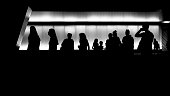 Silhouettes of young people in front of the modern building