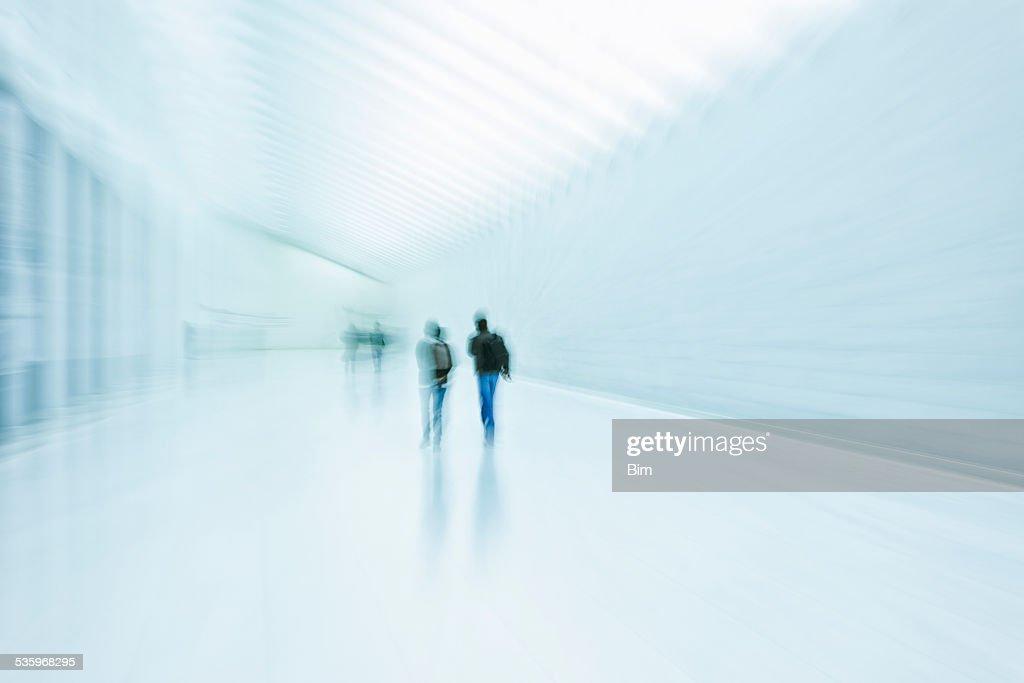People Silhouettes in Corridor : Stock Photo