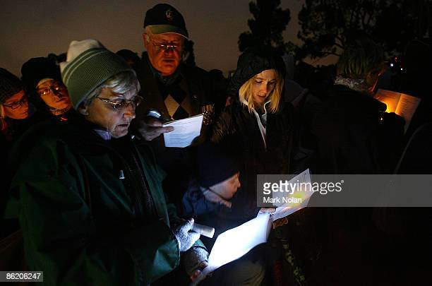 People sing a hymn during the ANZAC dawn service at the Australian War Memorial on April 25 2009 in Canberra Australia Today commemorates the 94th...