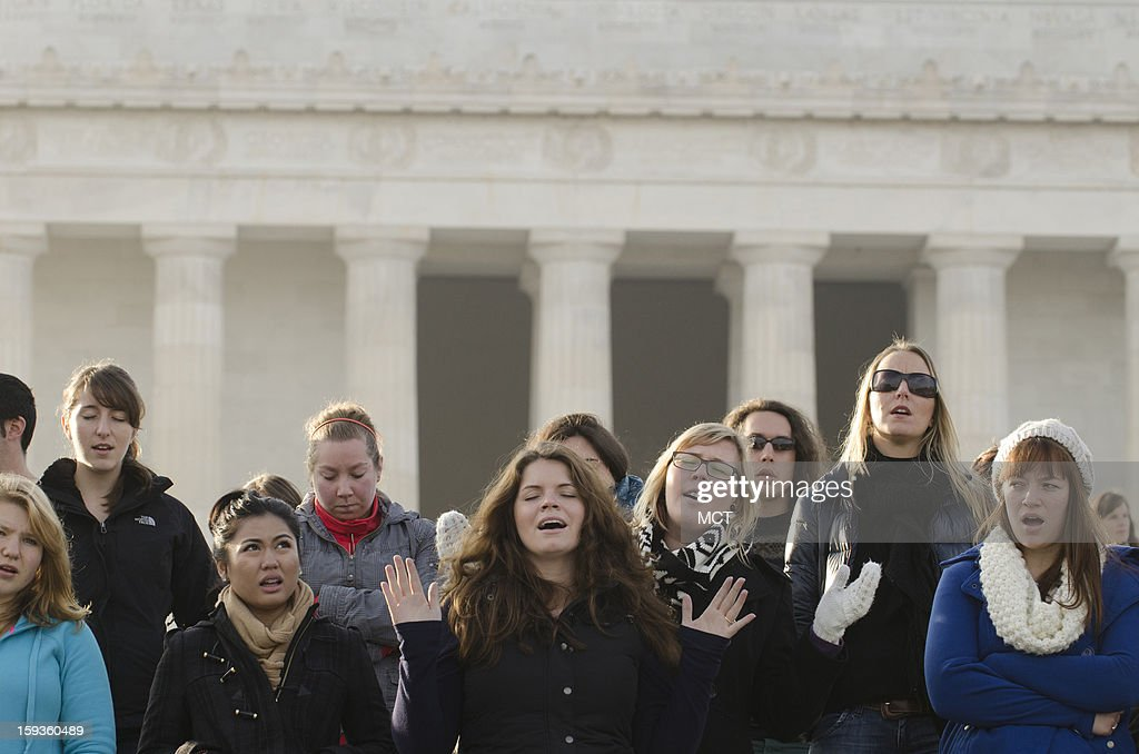 People sing 'Amazing Grace' during the Washington DC Emancipation Rally, A Prayer rally to End Modern-Day Slavery and Human Trafficking, at the Lincoln Memorial in Washington, D.C., Sunday, January 12, 2013. The rally, which is meant to raise awareness of human trafficking, is being held in conjunction with the Weekend of Prayer to End Slavery and Trafficking.
