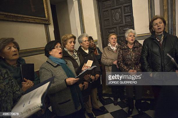 People sing during a mass funeral held in Santos Justo y Pastor Church in Granada in memory of Juan Alberto Gonzalez Garrido one of the victims of...