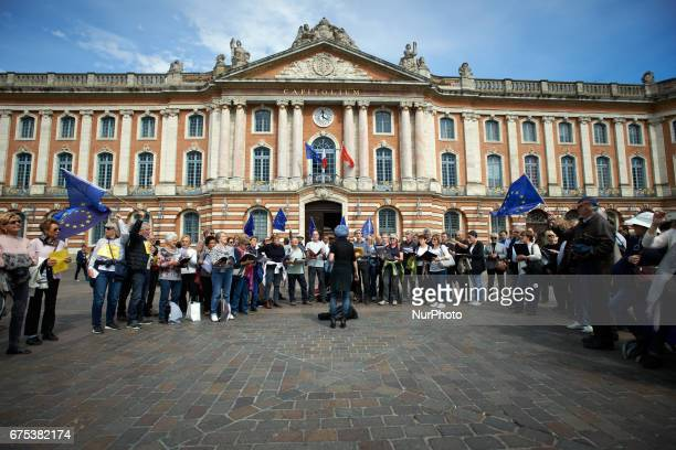 People sing the European anthem in front of the townhall of Toulouse the Capitole in Toulouse France on April 30 2017 The 'Pulse of Europe' movement...