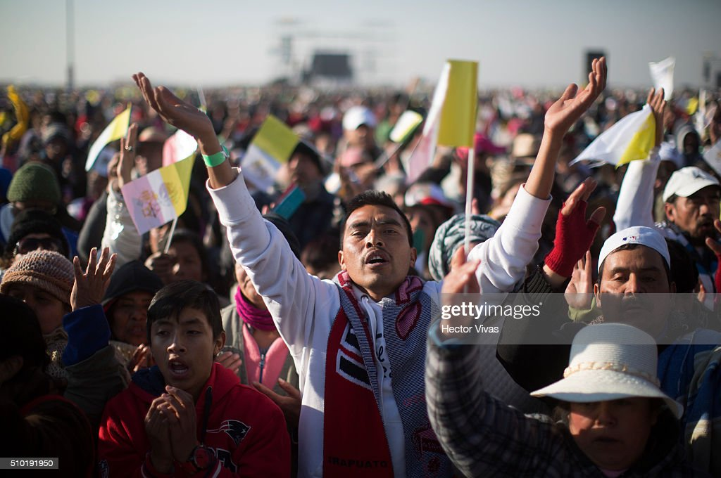 People sings during a mass at Ecatepec on February 14, 2016 in Ecatepec, Mexico. Pope Francis is on a five-day visit in Mexico from February 12 to 17 where he is expected to visit five states.