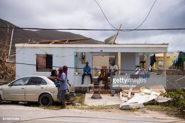 People sit among damage on September 7 2017 on the French Carribean island of SaintMartin after the passage of Hurricane Irma France the Netherlands...