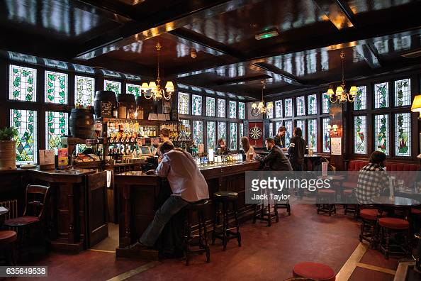 People sit and drink in the Angel in the Fields pub in Marylebone on February 16 2017 in London England The Association for Licensed Multiple...