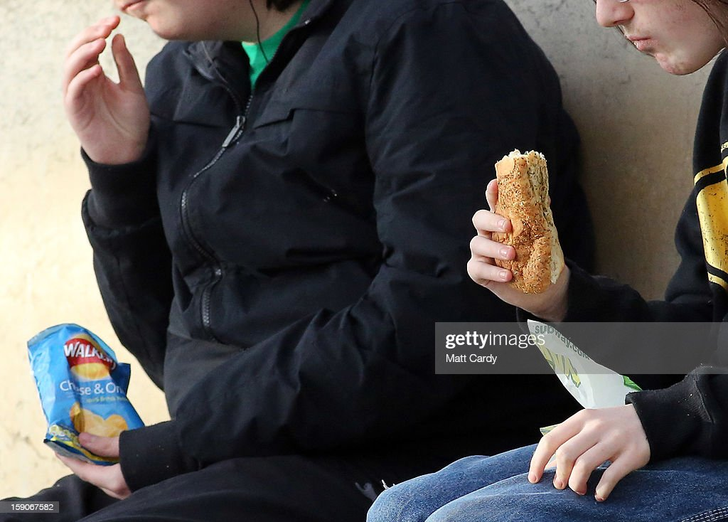 People sit and eat takeaway and convenience food on January 7, 2013 in Bristol, England. A government-backed TV advert - made by Aardman, the creators of Wallace and Gromit - to promote healthy eating in England, is to be shown for the first time later today. England has one of the highest rates of obesity in Europe - costing the NHS 5 billion GDP each year - with currently over 60 percent of adults and a third of 10 and 11 year olds thought to be overweight or obese.