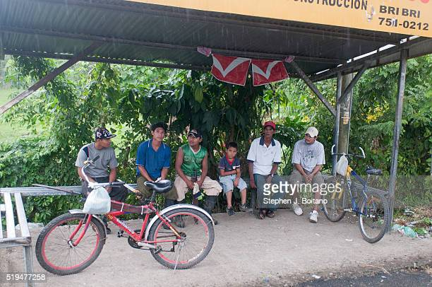 People sit at a bus stop in Puerto Viejo Costa Rica