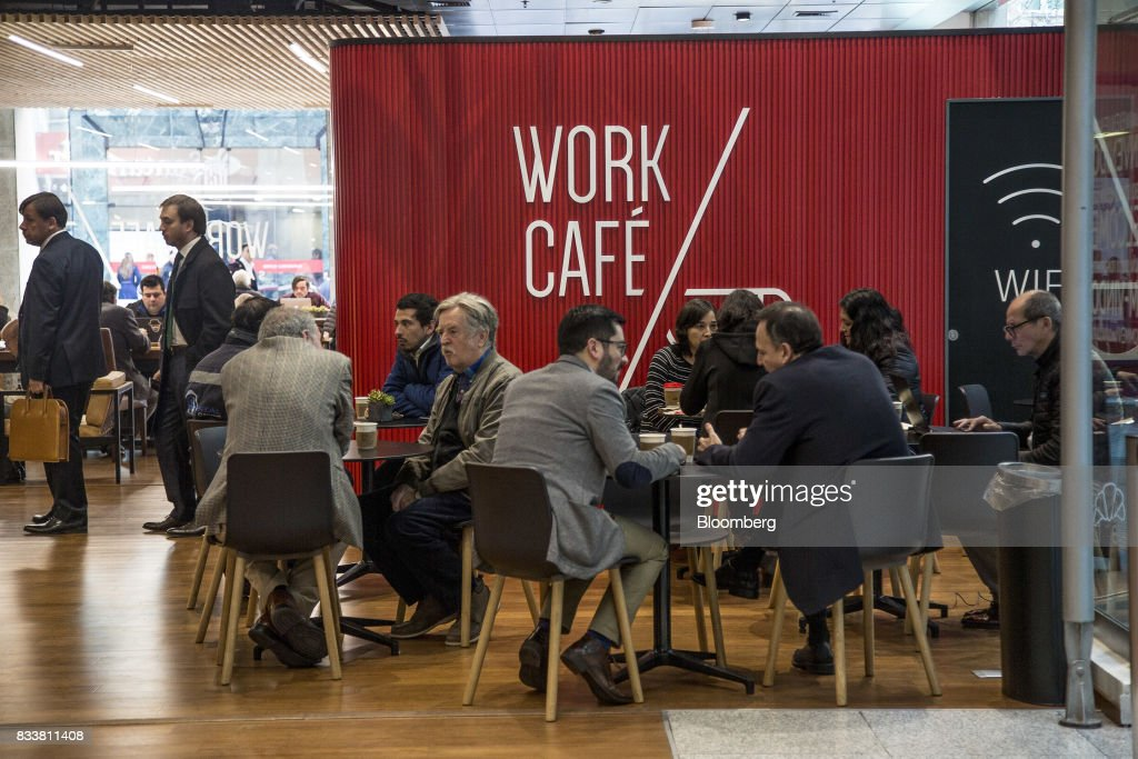 People sit at Banco Santander Chile's Work/Cafe in Santiago, Chile, on Wednesday, Aug. 16, 2017. Banco Santander Chile is the largest bank in the region in terms of total assets and equity. Photographer: Cristobal Olivares/Bloomberg via Getty Images