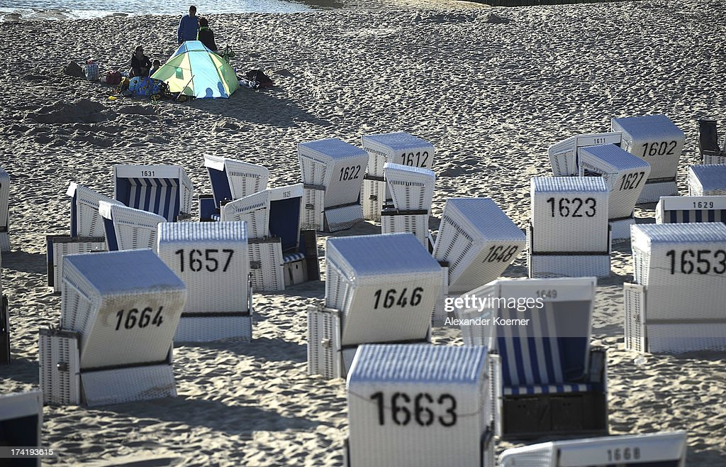 People sit at dusk on Brandenburger Beach on July 21, 2013 in Westerland, Germany. The weather forecast for the next three days predicts sunny weather with heights of 30¡ Celsius for the north of Germany.