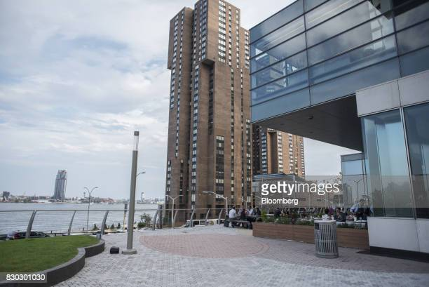 People sit at tables outside the Alexandria Center For Life Science building in New York US on Thursday Aug 3 2017 Alexandria LaunchLabs which began...