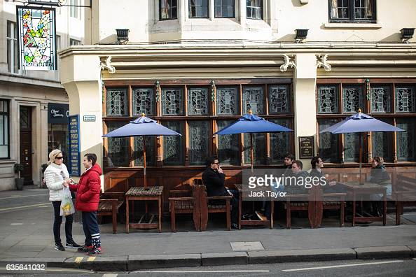 People sit at the Angel in the Fields pub in Marylebone on February 16 2017 in London England The Association for Licensed Multiple Retailers have...