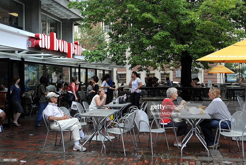 People sit at the original Au Bon Pain in Harvard Square July 30, 2009 Cambridge, Massachusetts. Harvard Square is a large triangular area located in the heart of Cambridge and adjacent to Harvard University, and is frequented by tens of thousands of tourists a year, and home to thousand of students with MIT University just down the road.