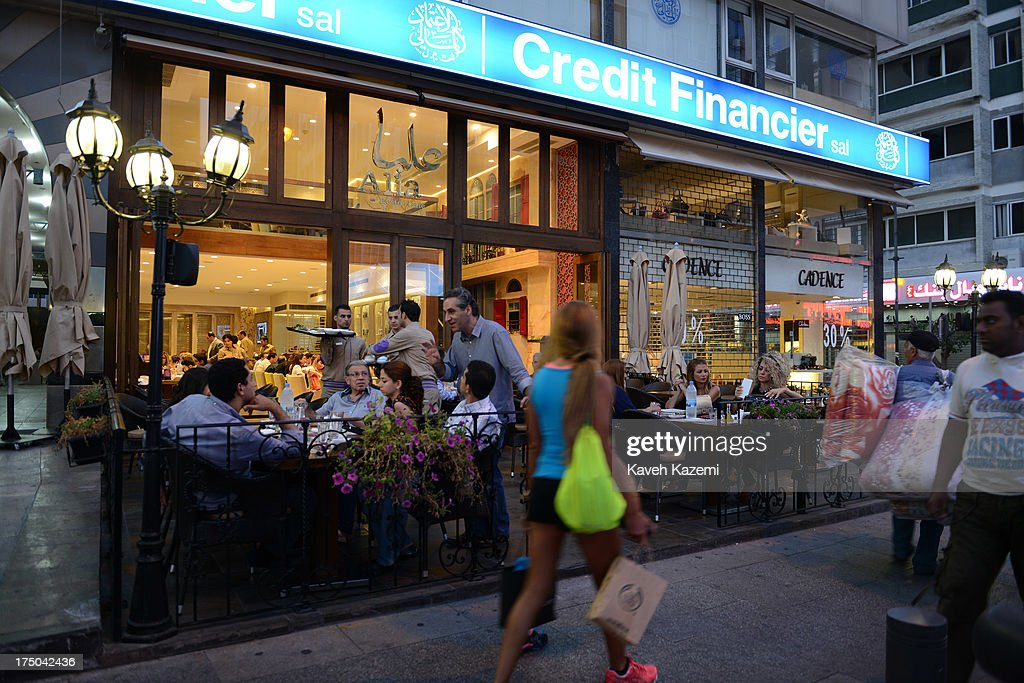 People sit dinning on the terrace of Alia restaurant in Hamra street on July 17, 2013 in Beirut, Lebanon.