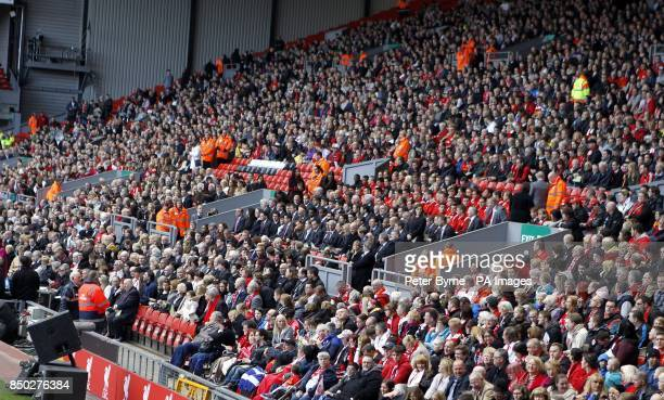 People sit during the Hillsborough disaster memorial service at Anfield marking the 24th anniversary of the disaster as they remember the 96...