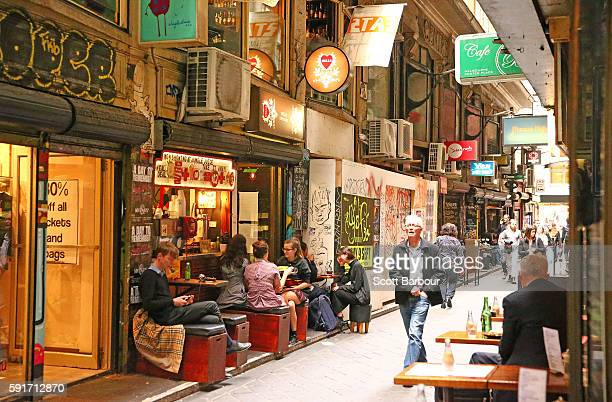 People sit in a cafe on Degraves Street one of Melbourne's iconic laneways on August 18 2016 in Melbourne Australia Melbourne has been named as the...