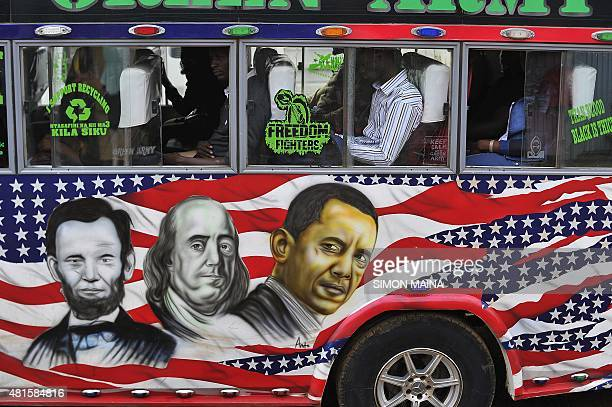 People sit in a 'matatu' minibus with a painting depicting US Presidents Abraham Lincoln and Barack Obama and US scientist and statesman Benjamin...