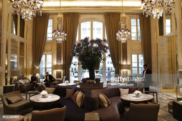 People sit in a room called 'Jardin d'Hiver' at the luxury Hotel de Crillon in Paris on June 30 2017 The Hotel de Crillon will reopen on July 5 after...