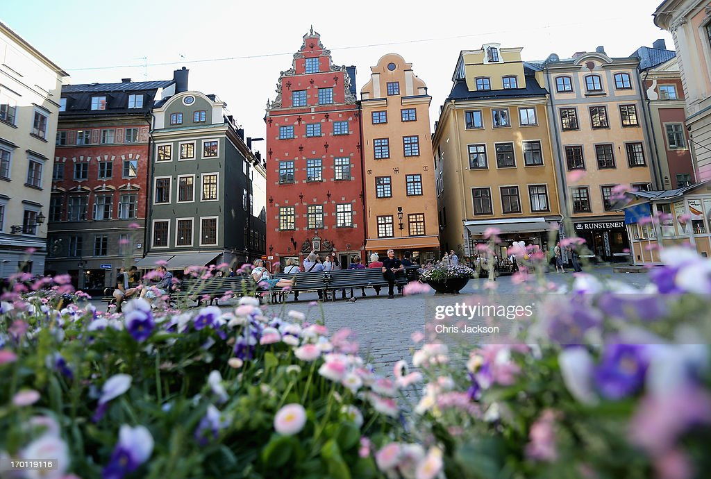 People sit in a square as preparations for the wedding of Princess Madeleine of Sweden and Christopher O'Neill continues on June 7, 2013 in Stockholm, Sweden.