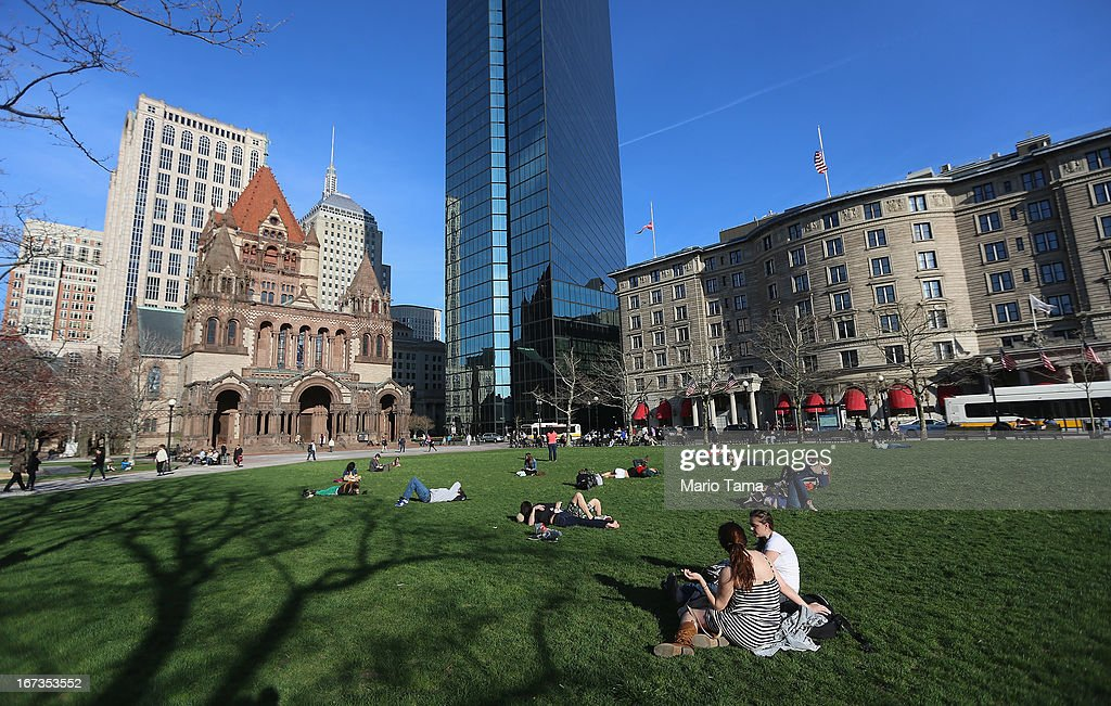 People sit in Copley Square near the site of the Boston Marathon bombings on April 24 2013 in Boston Massachusetts Boylston Street the site of both...