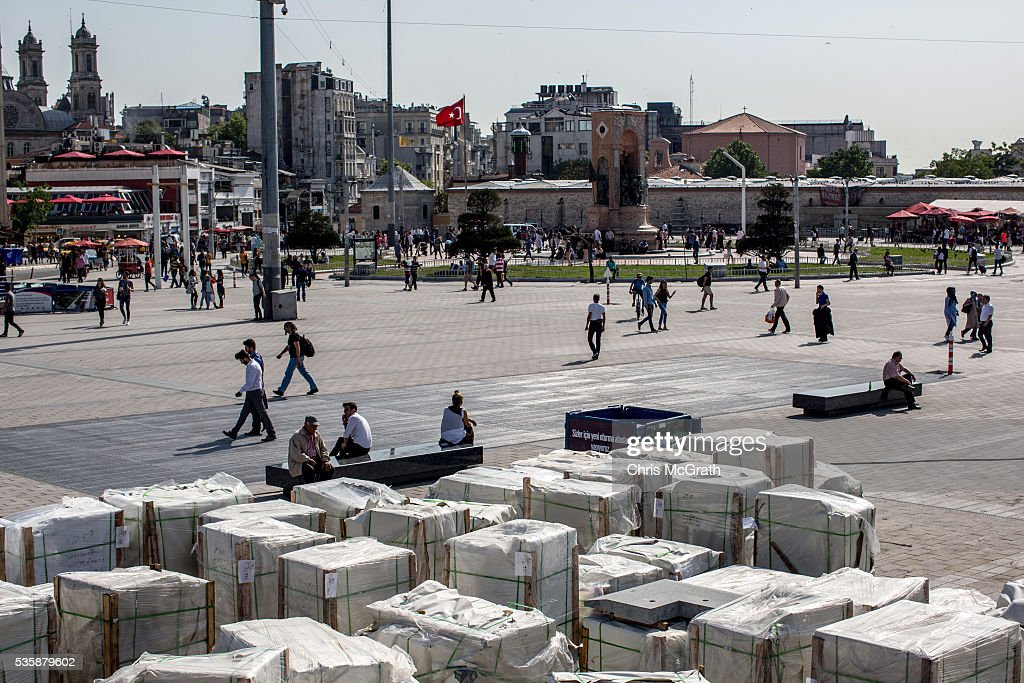 People sit in front of bricks being used in the redevelopment of Gezi Park and Taksim Square on the eve of the 3rd anniversary of the Gezi Park protests on May 30, 2016 in Istanbul, Turkey. The protests began on May 28, 2013 to contest the planned urban development of Gezi Park however larger protests started after police evicted protesters from the park sparking weeks of civil unrest.