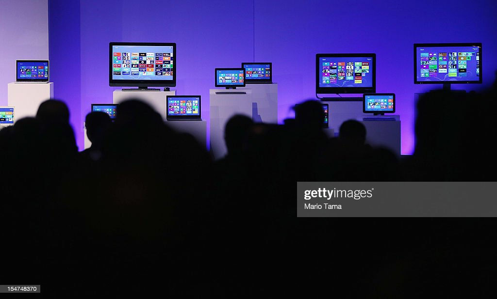 People sit in front of devices running the Microsoft Windows 8 operating system at a press conference launch of the system on October 25, 2012 in New York City. Windows 8 will offer a touch interface in an effort to bridge the gap between tablets, smartphones and personal computers. Microsoft will also be selling a tablet called Surface to compete in the competitive tablet market.
