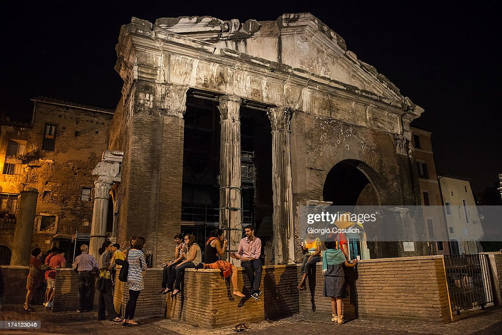 People sit in front of 'Portico d'Ottavia' ruins in the Ghetto district during the opening of the International Festival of Jewish Culture and Literature on July 20, 2013 in Rome, Italy. The International Festival of Jewish Culture will take place July 20 to 25.