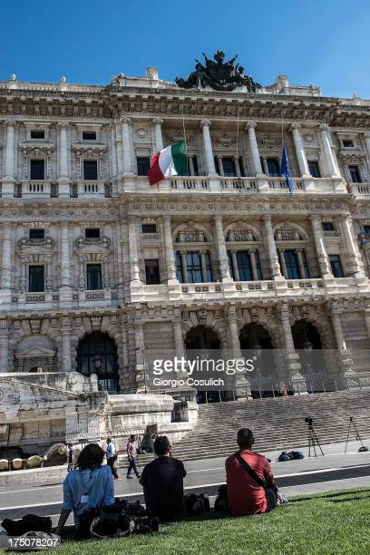 People sit in front of the 'Corte di Cassazione' during the final session to judge former Italian Prime Minister Silvio Berlusconi on July 31 2013 in...
