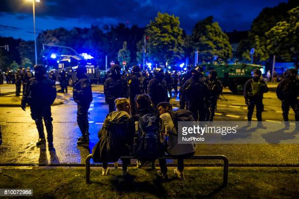 People sit in front of the place in Hamburg Germany on July 6 2017 The police stopped the leftradical demonstration quotG20 Welcome to Hellquot and...