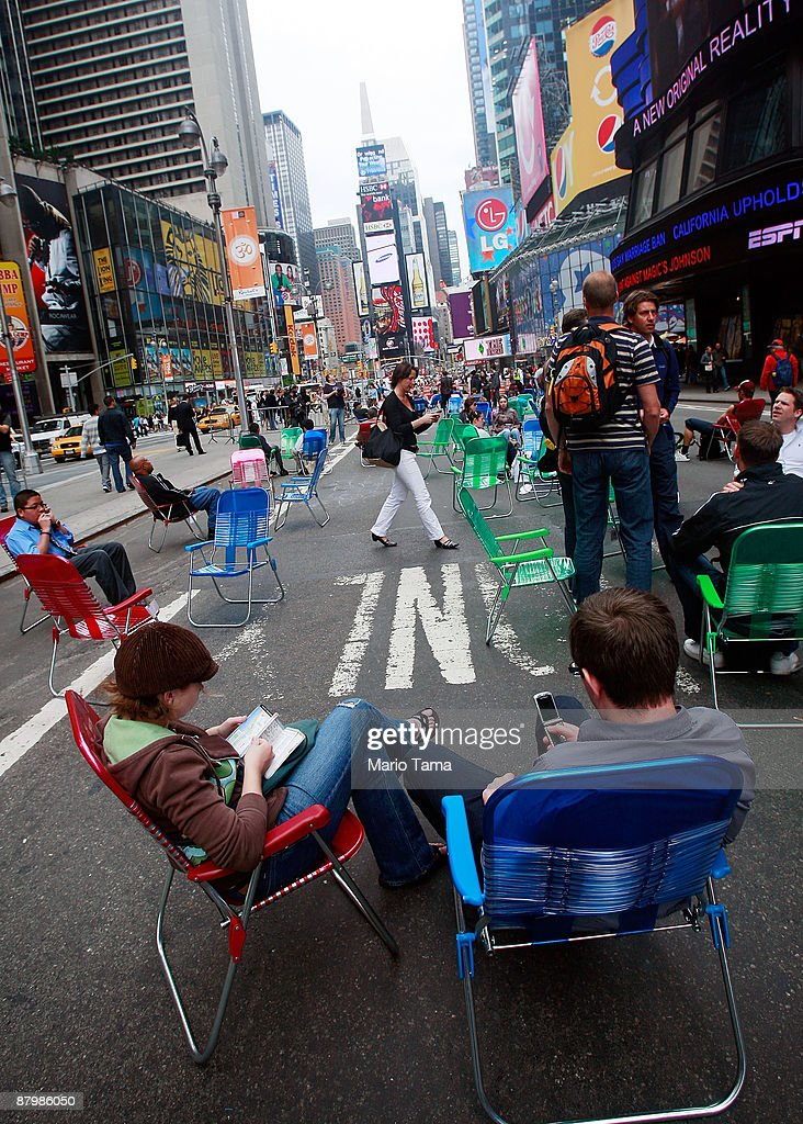 People sit in lounge chairs on Broadway in Times Square after it was converted to a pedestrian zone May 26, 2009 in New York City. Sections of Broadway that pass through Times Square and Herald Square have been closed to vehicles in an effort by the city to reduce traffic and pollution while giving pedestrians more space.