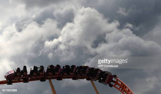 People sit in roller coaster of the 184th Oktoberfest beer festival in Munich southern Germany September 16 2017 The world's largest beer festival is...