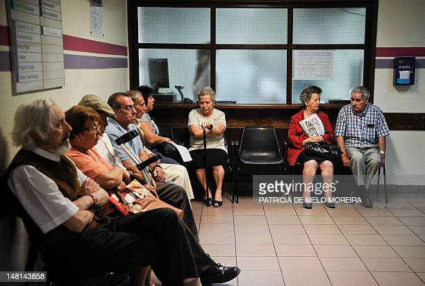 People sit in the in Sao Jose hospital waiting room during a doctors strike in Lisbon on July 11 2012 Doctors are on strike until July 12 with it is...