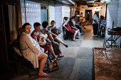 People sit inside a bomb shelter in a maternity hospital during shelling in Donetsk eastern Ukraine on August 10 2014 Artillery pounded the...
