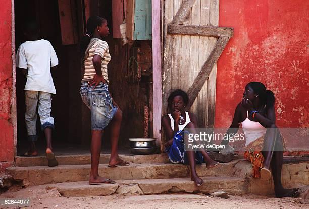 People sit on a beach on the Ile De Gore island on December 27 2007 near Dakar Republic of Senegal The Ile De Gore island is situated off the main...