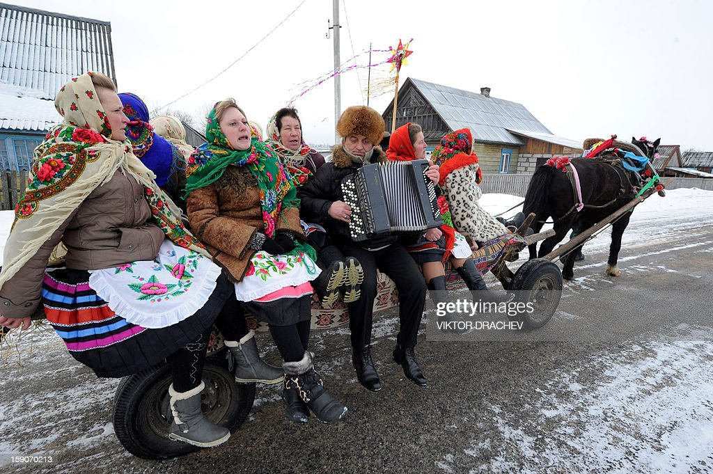 People sit on a horse-drawn cart as they attend Christmas celebrations in the town of Richev, some 290 km south from Minsk, on January 7, 2013. Orthodox Christians celebrate Christmas on January 7 in the Middle East, Russia and other Orthodox churches that use the old Julian calendar instead of the 17th-century Gregorian calendar adopted by Catholics, Protestants, Greek Orthodox and commonly used attendsin secular life around the world. AFP PHOTO / VIKTOR DRACHEV