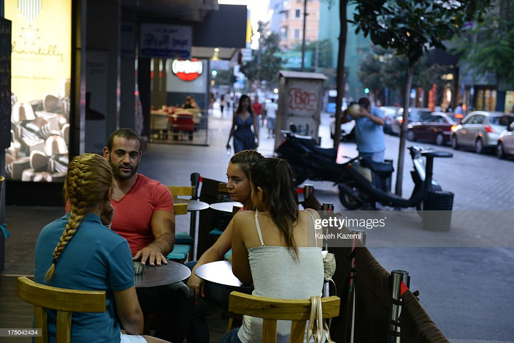 People sit on the terrace in Brisk cafe in Hamra street on July 17, 2013 in Beirut, Lebanon.