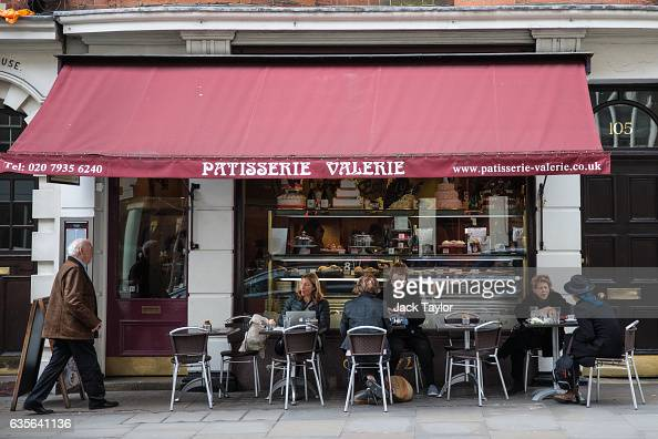 People sit outside a Patisserie Valerie in Marylebone on February 16 2017 in London England The Association for Licensed Multiple Retailers have...