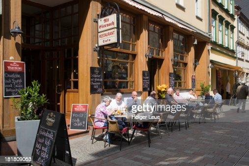 People sit outside Alt Eisenach restaurant