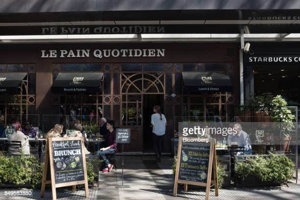 People sit outside at a Le Pain Quotidien Ltd restaurant in the Recoleta neighborhood of Buenos Aires Argentina on Sunday Sept 17 2017 The National...