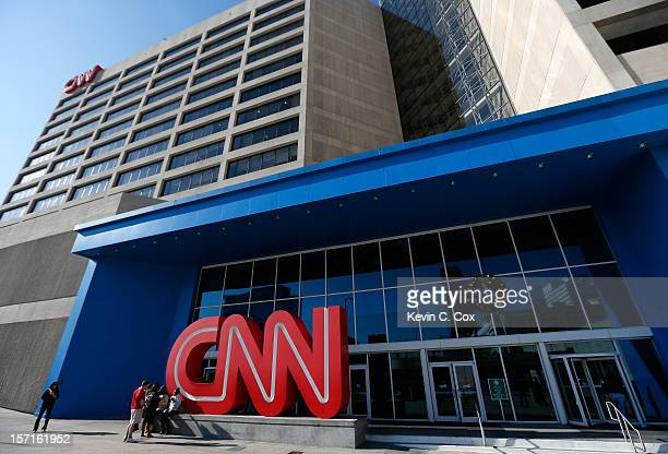 People sit outside of the CNN Center on November 29 2012 in Atlanta Georgia CNN announced that is has named former NBC Universal chief Jeff Zucker as...