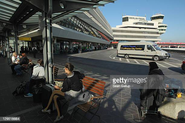 People sit outside the main terminal at Tegel Airport on October 17 2011 in Berlin Germany Tegel which first went into operation in 1960 and whose...