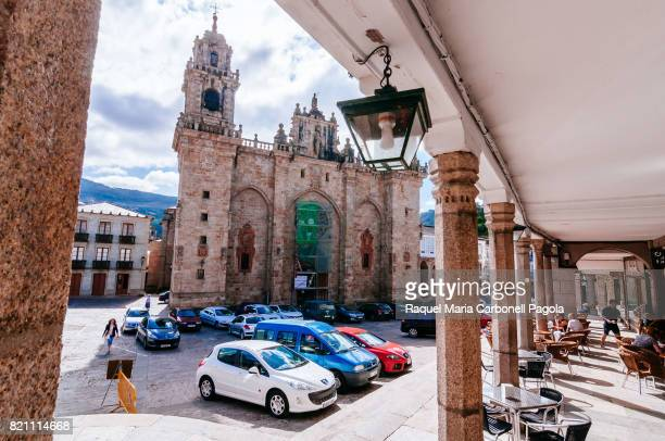 MONDOñEDO LUGO GALICIA SPAIN People sitting at a cafe bar terrace in front of the Cathedral of Mondoñedo