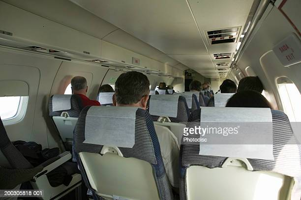 People sitting in aeroplane, elevated view