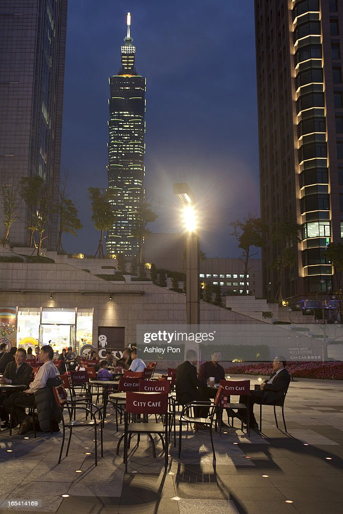 People sitting in an outdoor cafe at night in front of Taipei 101 building at the shopping district in Taipei's Hsin-yi district on April 3, 2013 in Taipei, Taiwan. Franchise and chain operations in Taiwan's retail and food sectors make up 50 per cent of sales, and 25 per cent of the service sector.