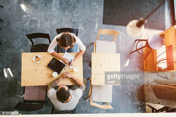 People Sitting In Cafe