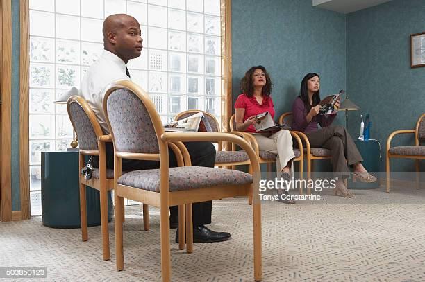 People sitting in dental office waiting room