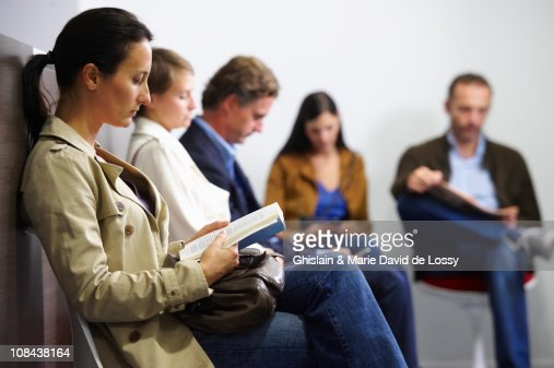 People sitting in waiting room : Stock Photo