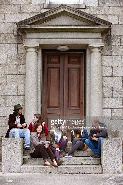 People sitting on steps outdoors