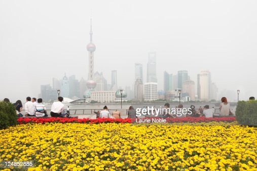 People Sitting on The Bund looking at Pudong : Stock Photo