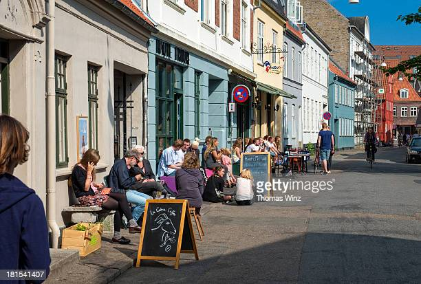 People sitting outside a cafe in Aarhus