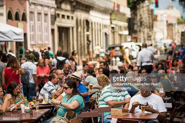 People sitting outside restaurant, Feria do Lavrendio, Lapa, Rio De Janeiro, Brazil